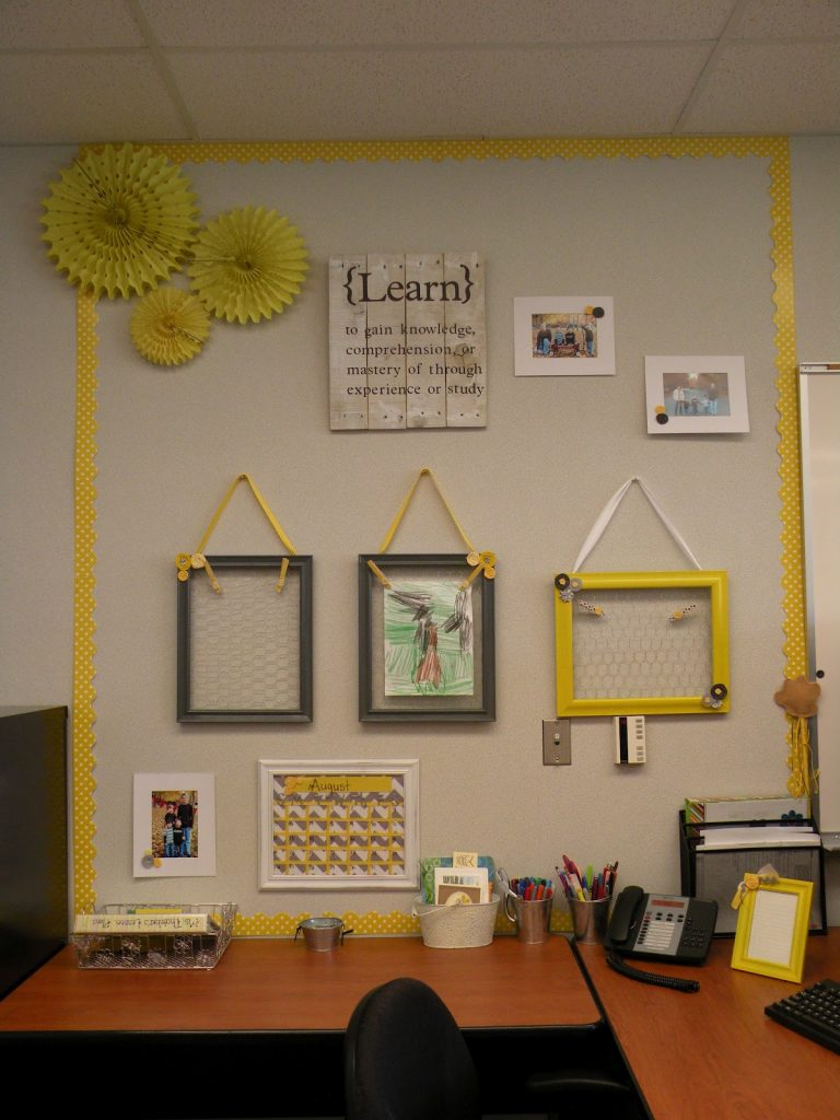 Love the Picture Frame Display in this Bright Yellow and Grey Classroom