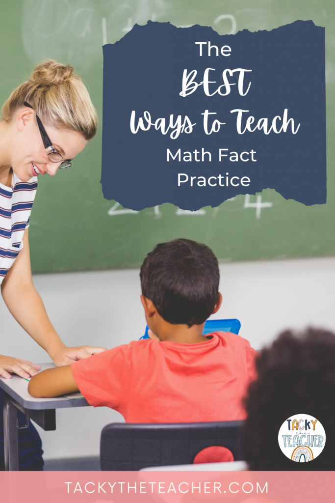 Woman teacher who is working with a student in front of a chalkboard with math facts written on the board